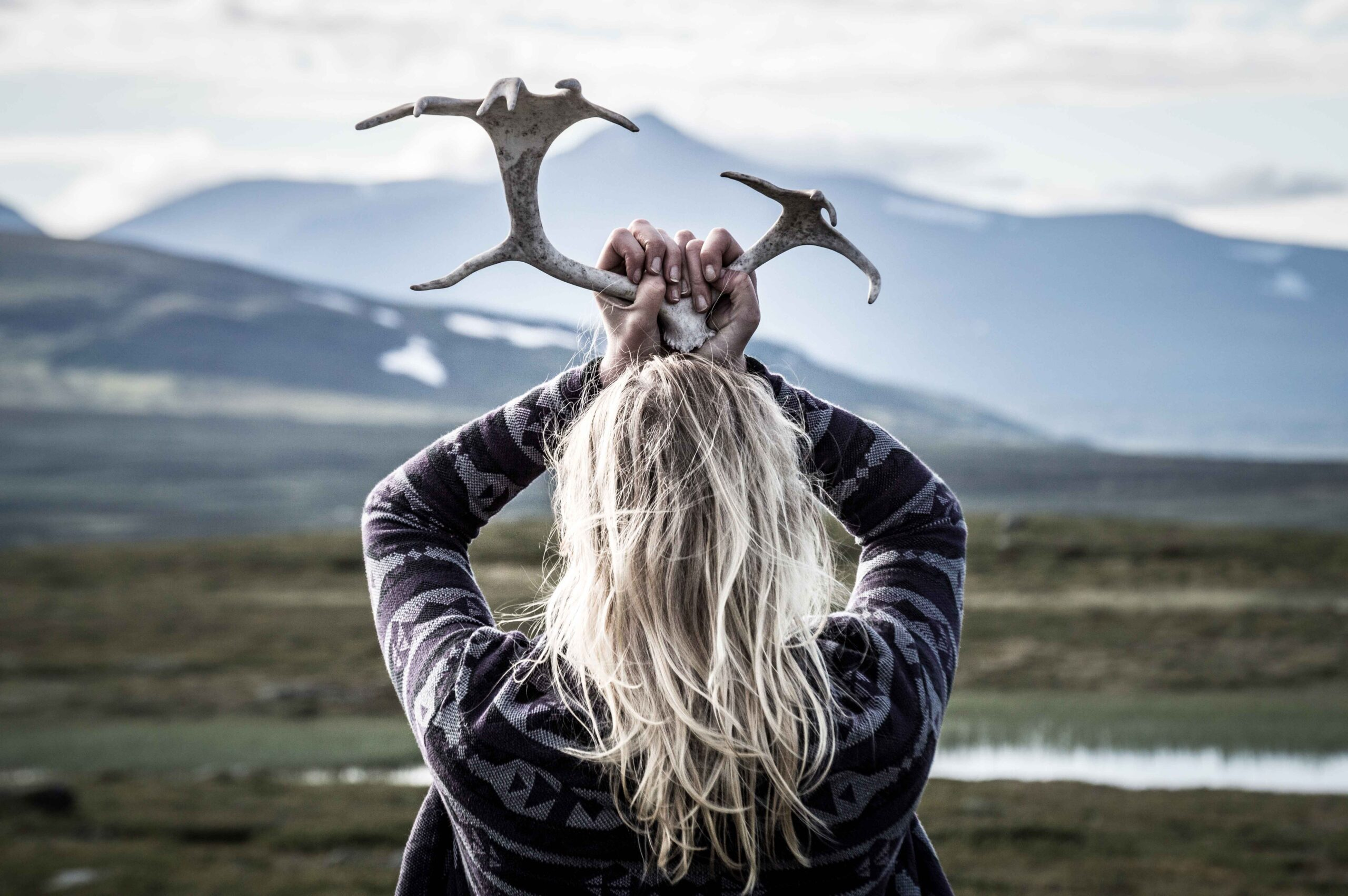 Nordic woman holding antlers